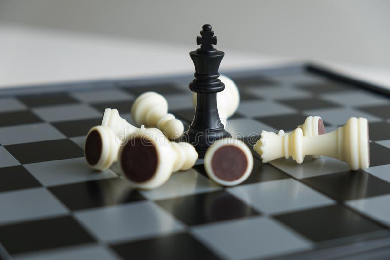 Chess pieces on board with white background, driven to success Business Strategy.  royalty free stock image