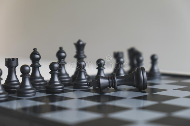 Chess pieces on board with white background, driven to success Business Strategy.  royalty free stock photography