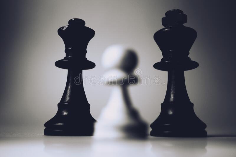 Chess pieces on board royalty free stock image