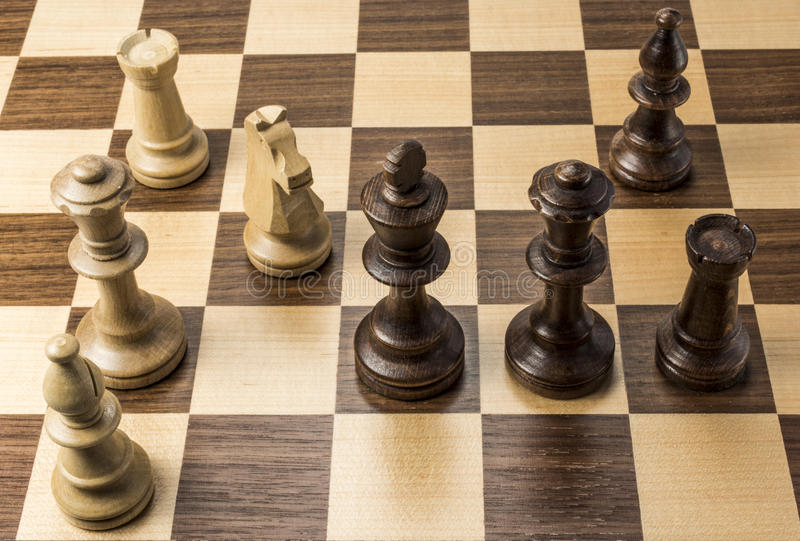 Chess pieces in checkmate position. Chess pieces on game board showing king one move from checkmate royalty free stock photo
