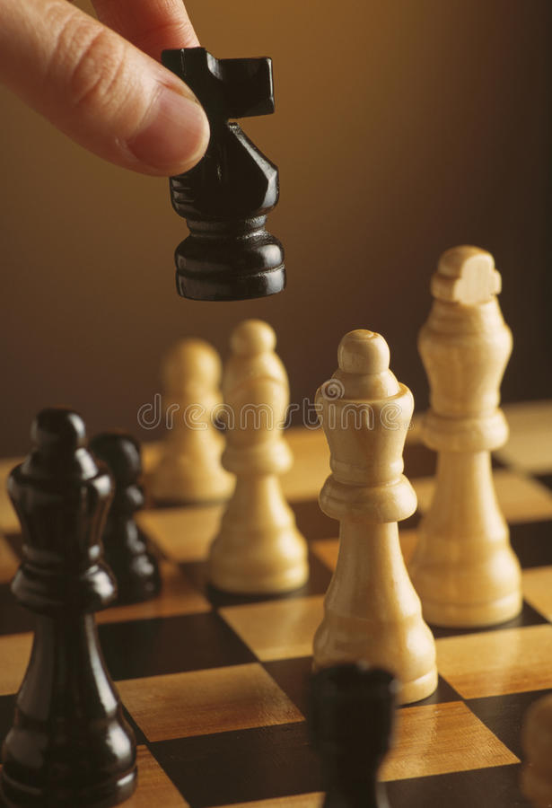 Chess pieces on chess board. Chess pieces on a chess board royalty free stock photos