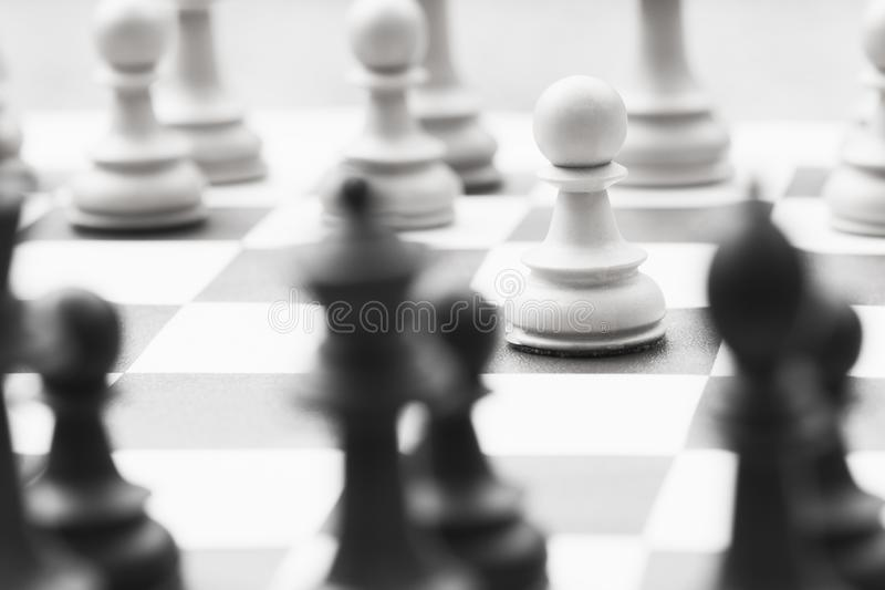 Chess pieces chess board. The chess pieces are on chess board, close-up of playing chess leisure game royalty free stock photo