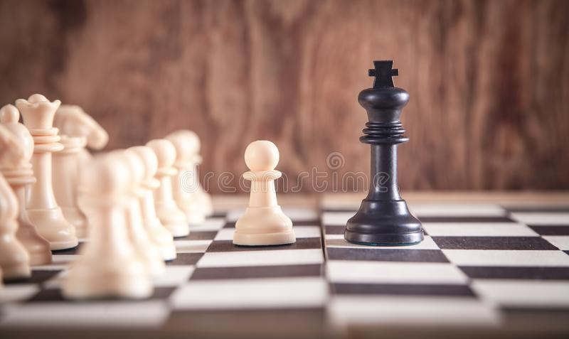 Chess pieces on the chessboard. Chess game royalty free stock image