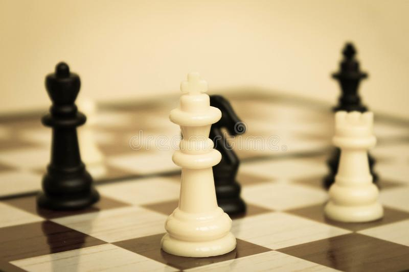Chess pieces on chessBoard close up stock photography
