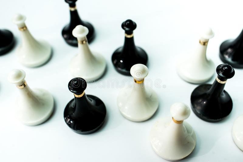 Chess pieces  on chessboard on white background. Chess king and queen on chessboard on black background rules power stock photo