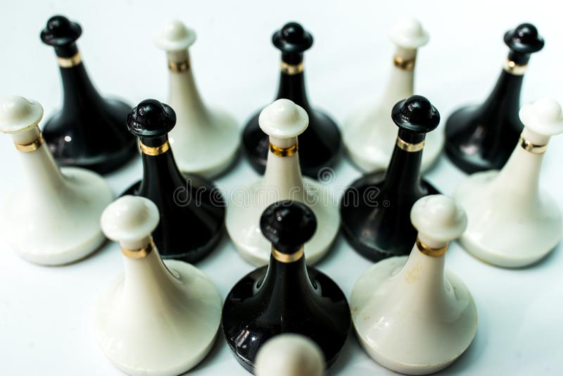 Chess pieces  on chessboard on white background. Chess king and queen on chessboard on black background rules power royalty free stock photo