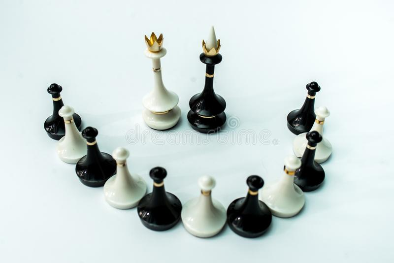 Chess pieces  on chessboard on white background. Chess king and queen on chessboard on black background rules power stock images