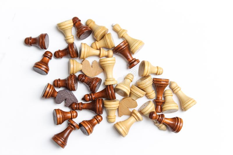Chess pieces fall on a white background.  royalty free stock photography