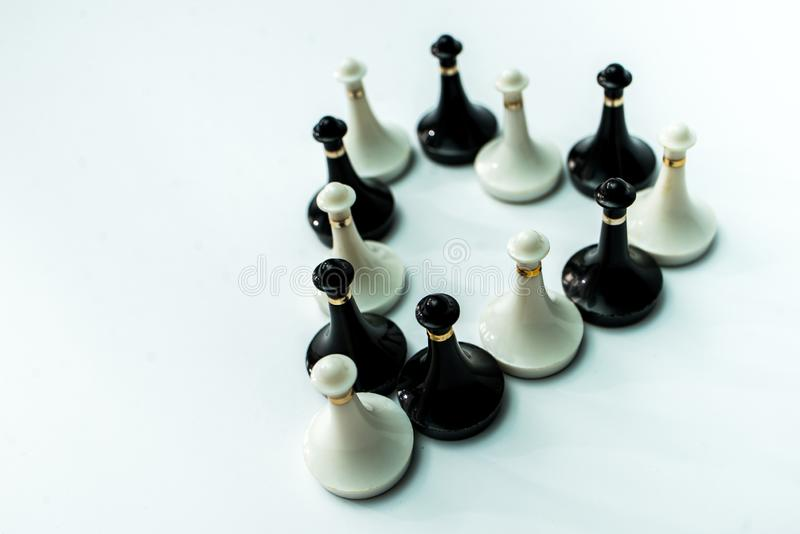 Chess pieces king and queen on chessboard on white background. Chess king and queen on chessboard on black background rules power royalty free stock photography
