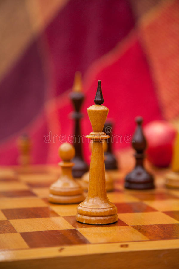 Chess pieces. Play chess in the park in two. royalty free stock images