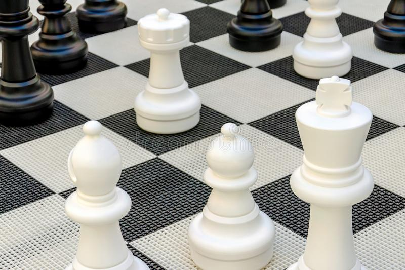 chess pieces stand on black and white squares. big chess. king, bishop, pawn, rook stock photography