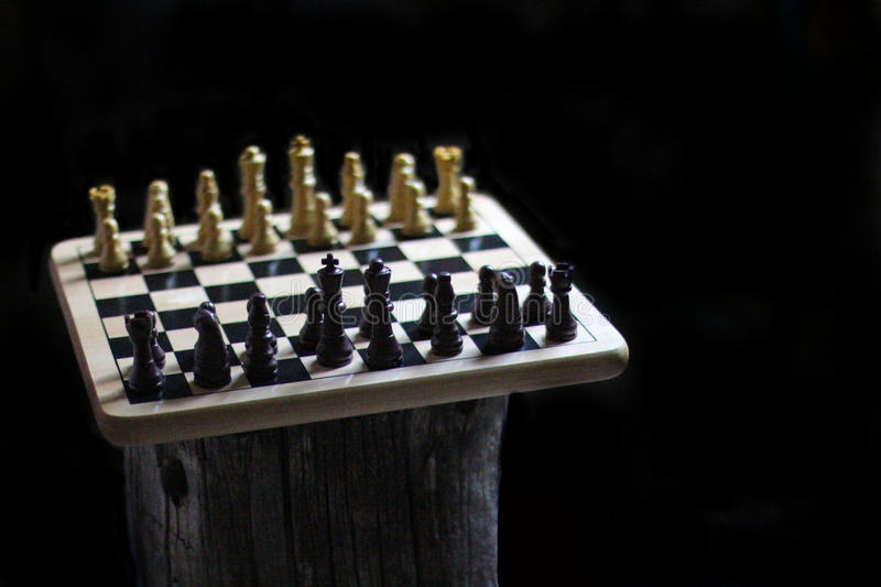 Chess Pieces on a wooden table stock image