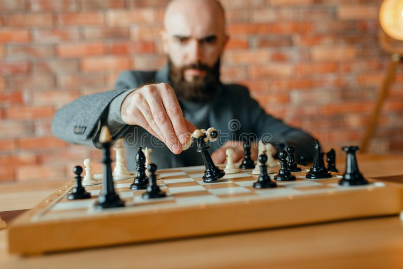 Chess player,white move, loss of the black queen royalty free stock images