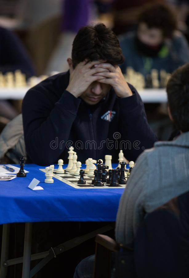 Chess players during gameplay at a local tournament vertical stock images