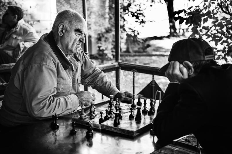 Chess Players thinking of the next move stock image