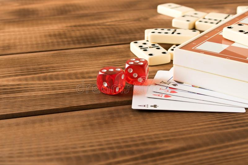 Chess, playing cards, dominoes on a wooden table. The concept of Board games.  royalty free stock photo