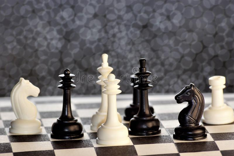 Chess is a popular ancient Board logic antagonistic game with special black and white pieces, on a cell Board for two intelligent stock photography