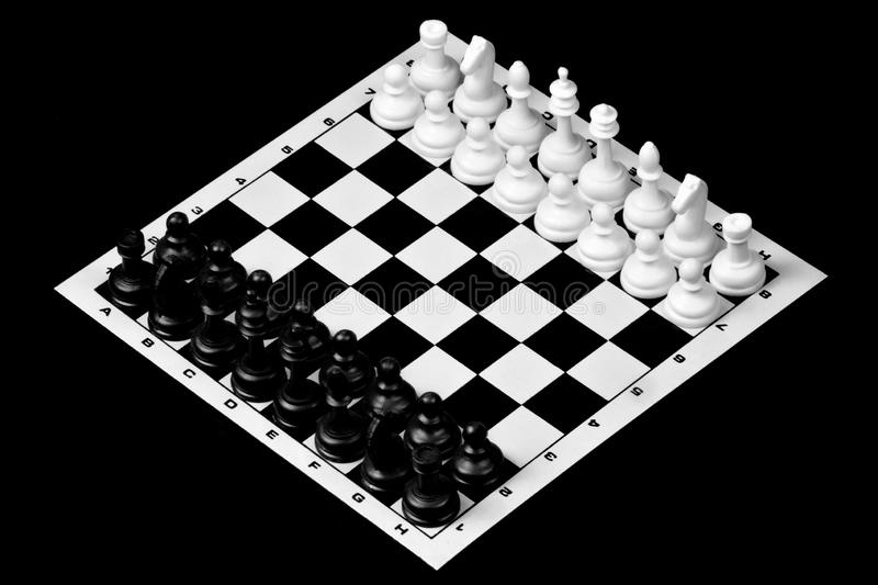 Chess is a popular ancient Board logic antagonistic game with special black and white pieces, on a cell Board for two intelligent royalty free stock photo