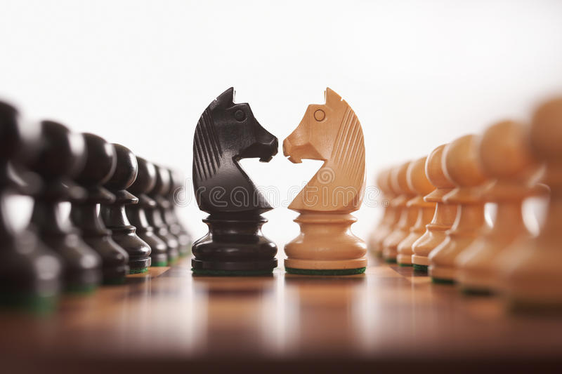 Chess rows of pawns with knight stock photography