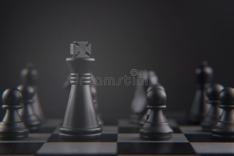 Chess set on chess board. black king and pawn pieces. leader, strategy and teamwork concept stock photos