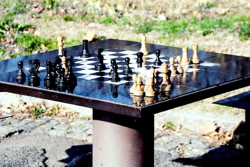 Chess table and chessman in the park, for active seniors royalty free stock images