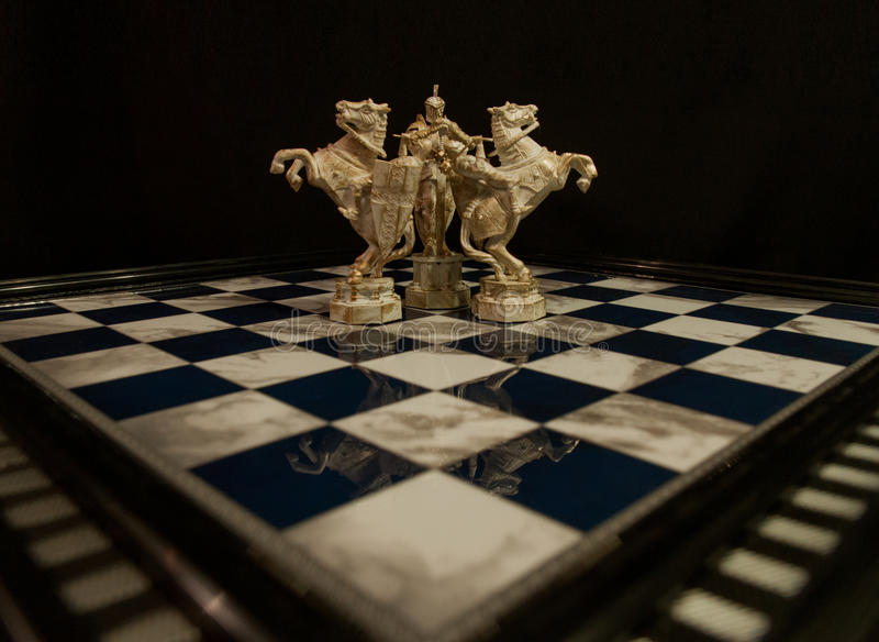 Chess white king and two white knights stock image