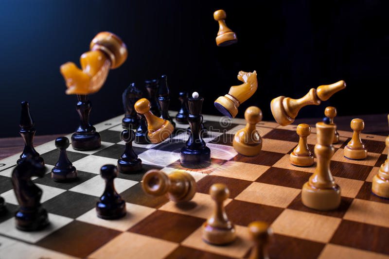 Chess on a wooden board stock images