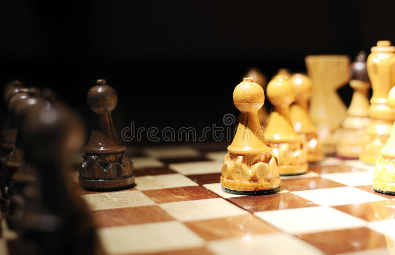 Chessboard 4. Game Chess. Chessboard , white pawn in focus.First move royalty free stock photography