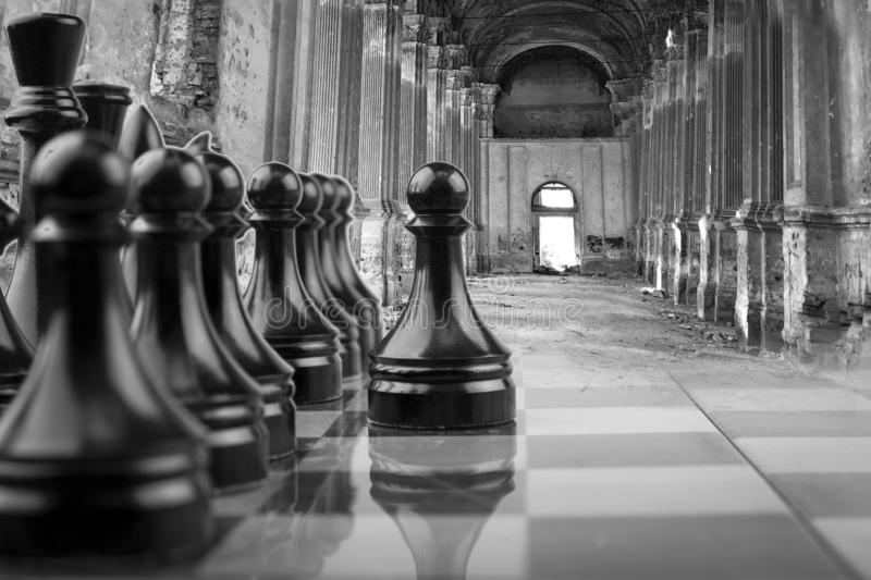 The Chessboard black pawns atack, logic game. royalty free stock photography