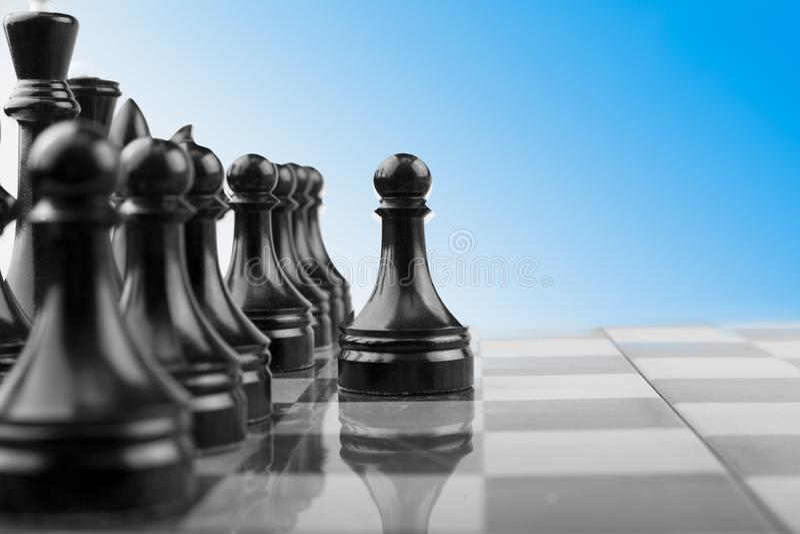 The Chessboard black pawns atack, logic game. royalty free stock photo