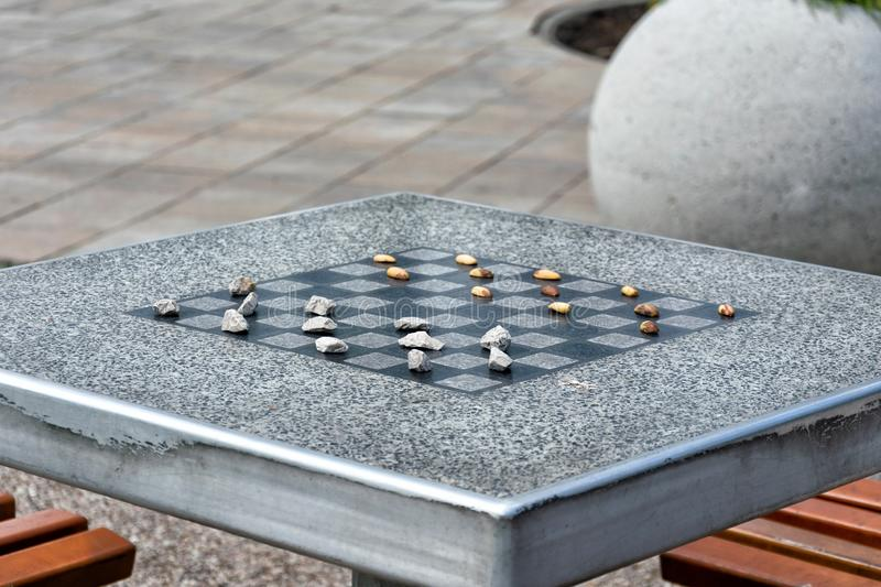Chessboard for chess or outdoor checkers in the park royalty free stock image