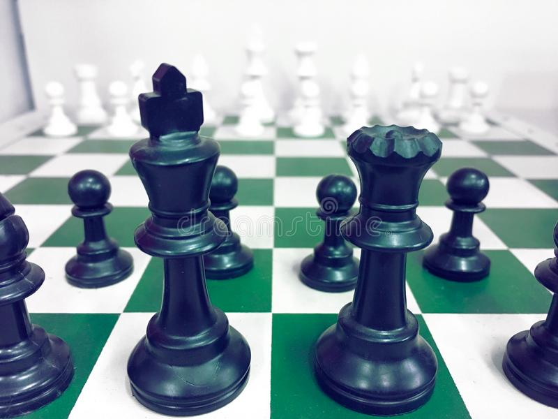 Chessboard with a chess piece on the back Negotiating in business. as background business concept and strategy concept stock images