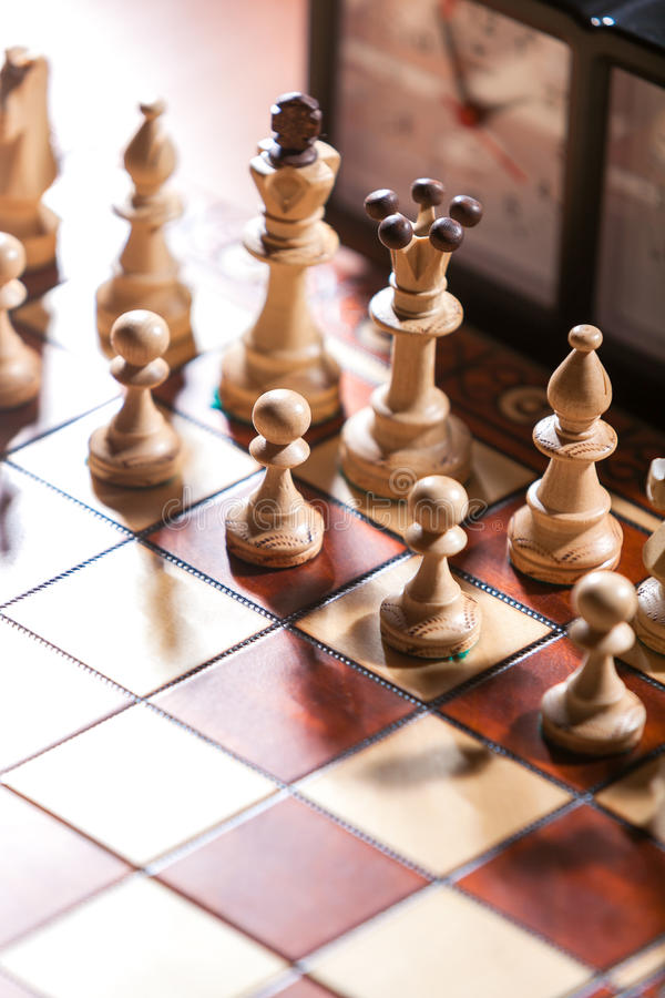 Chessboard, clock and figures. From above and vertical stock image