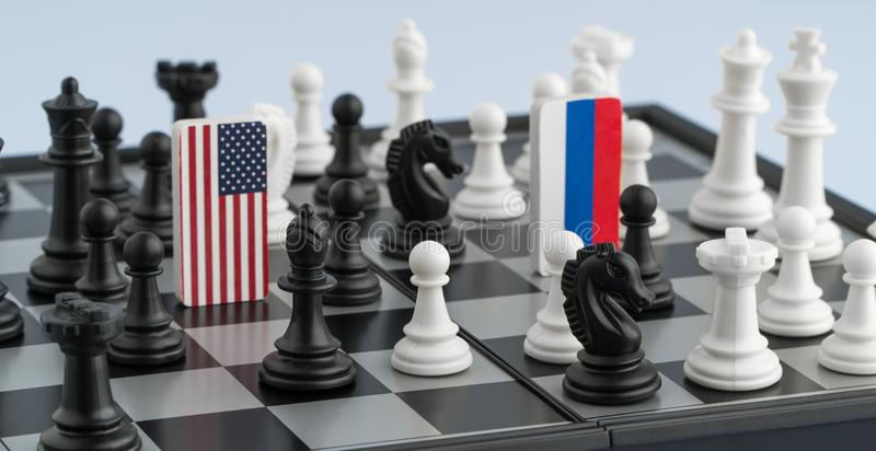 Chessboard with flags of countries stock images