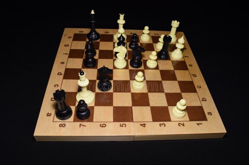 Chessboard i bierki dla umiejętność tematu obraz royalty free