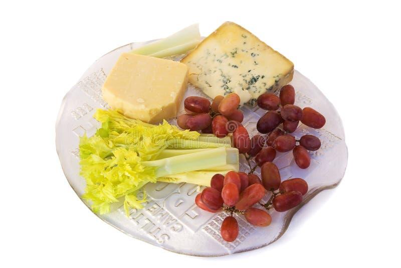 Chesses, céleri et raisins rouges images libres de droits