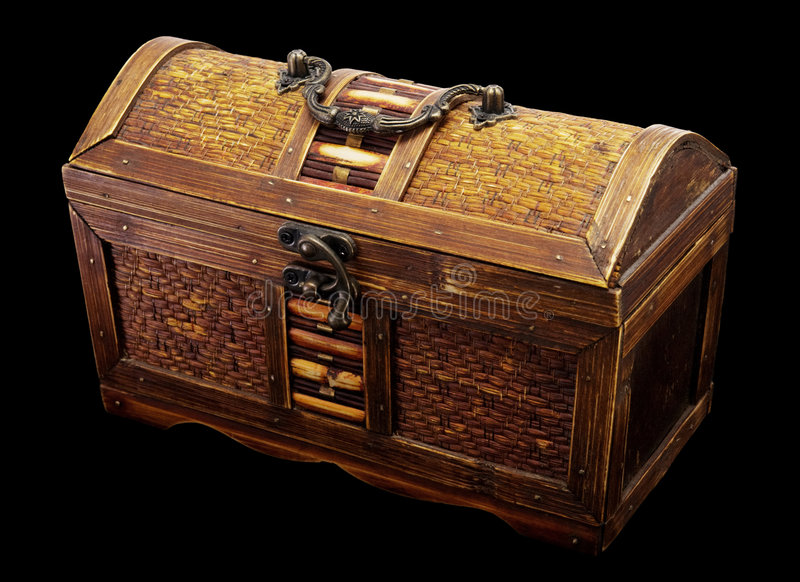 Chest. Wooden chest with iron handles on a dark background royalty free stock image