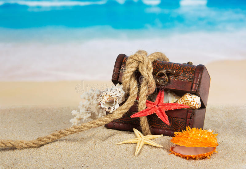 Chest with the cockleshells, closed by a rope stock photos