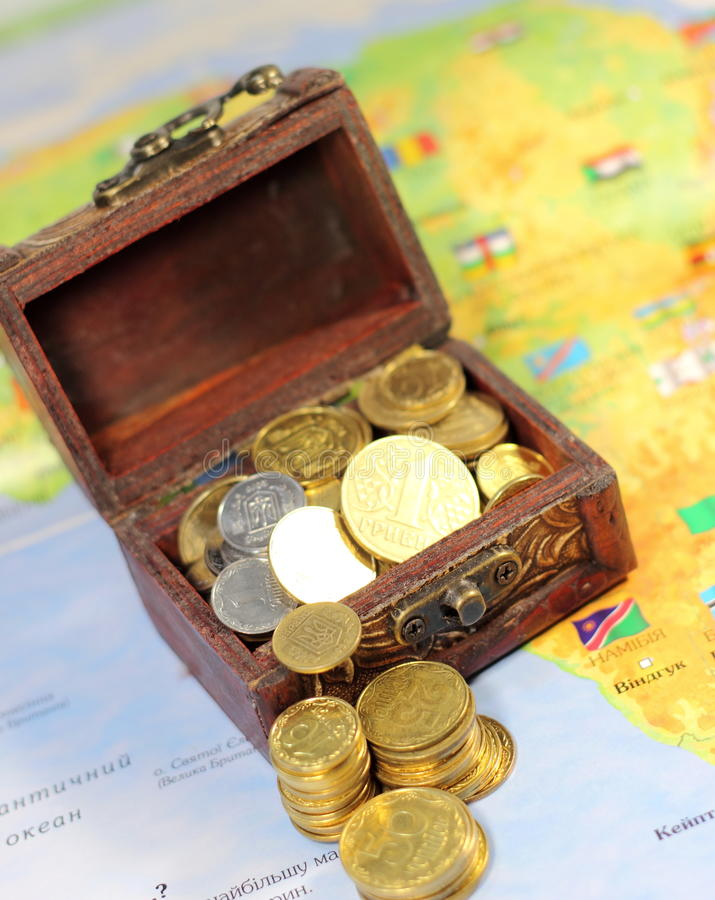 Chest with the coins. Open chest with the coins on a map. soft focus stock photo