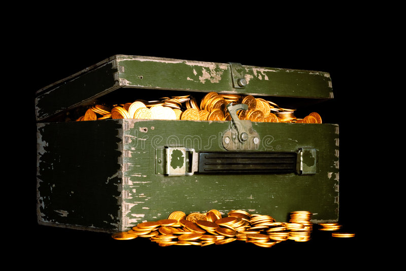 Chest full of gold. Riches, gold coins in a chest isolated on black royalty free stock photography