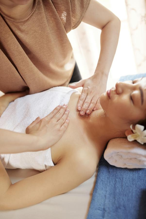 Chest and neck massage stock photo