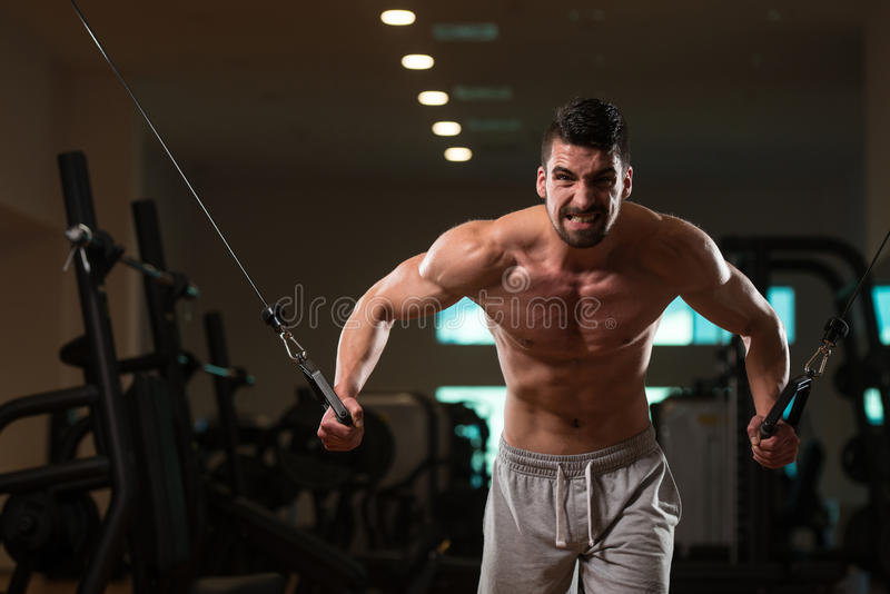 Chest Workout Cable Crossover. Young Bodybuilder Is Working On His Chest With Cable Crossover In Gym royalty free stock images
