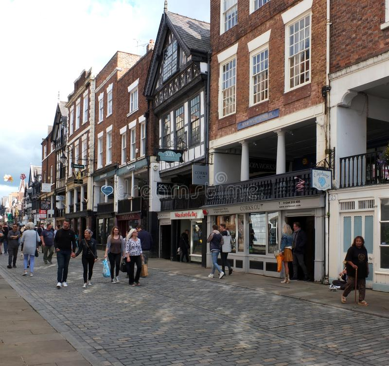 People walking along watergate street past pubs and shops in chester. Chester, cheshire, united kingdom - 7 september 2019: people walking along watergate street stock photography