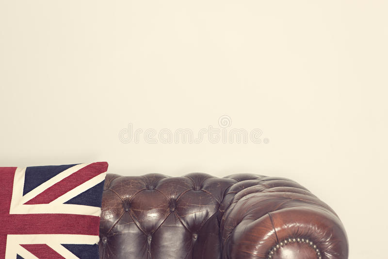 Chesterfield Couch. With union jack cushion stock photos