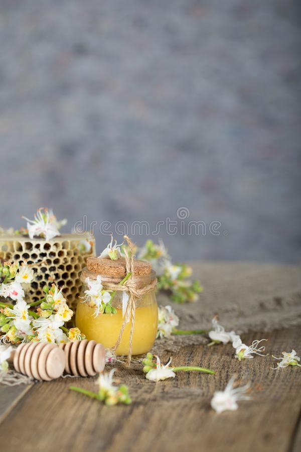 Chestnut honey on a wooden surface. Closeup stock photography