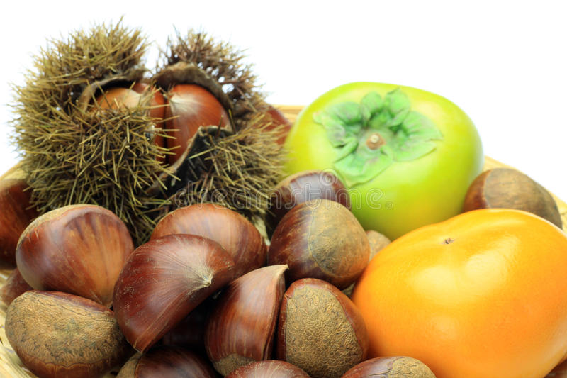 Chestnut and persimmon stock photos