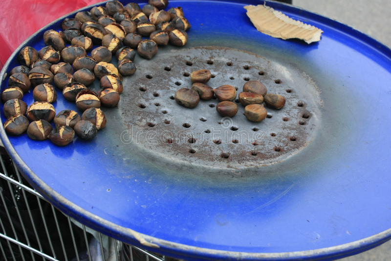 Chestnut Roasting Food Hot Autum Spring. Cold stock photography