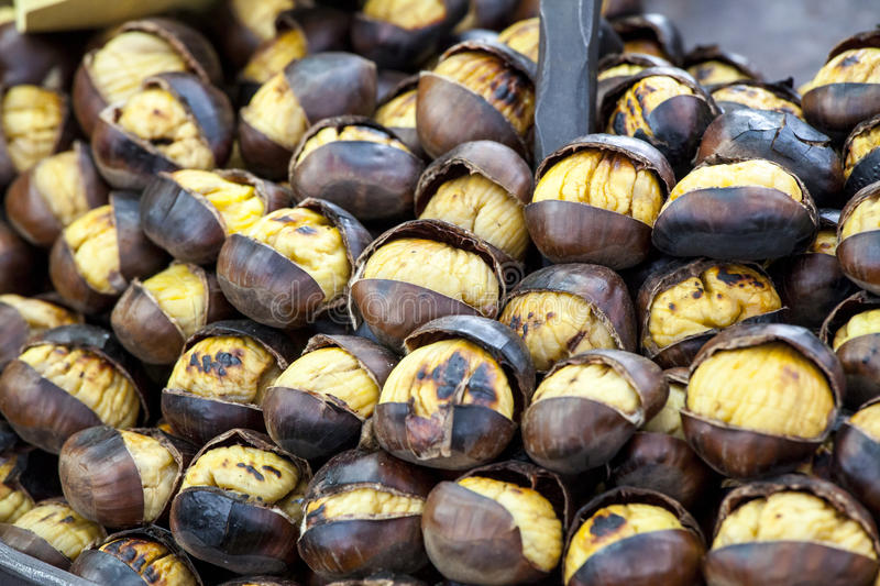 Chestnuts. Many cooked chestnuts. Roasted chestnuts stock photo