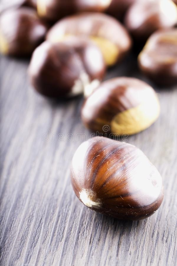 Chestnuts over wooden table stock photography