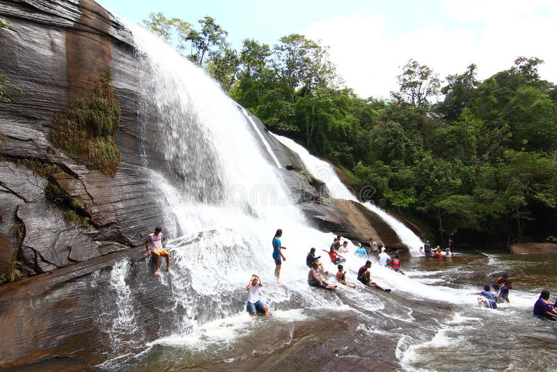 'Chet Si' Waterfall Bungkan thailand. BUNGKAN, THAILAND - August 22, 2015: Unknown person, 'Chet Si' Waterfall, People are playing waterfall. Bungkan 2015 royalty free stock photos
